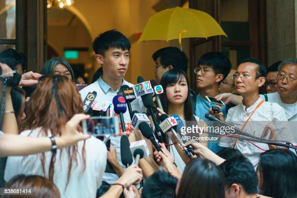 Proindependence activists Baggio Leung and Yau Waiching speak to reporters outside the Hong Kong Court of Final Appeal on August 25 2017 Two Hong...