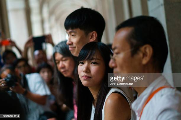 Proindependence activists Yau Waiching and Baggio Leung look on before speaking with reporters outside the Hong Kong Court of Final Appeal on August...