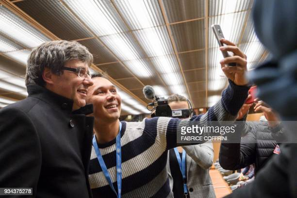 Proindependence Catalonia's deposed leader Carles Puigdemont takes a selfie with a parrticipant during a side event of the United Nations Human...