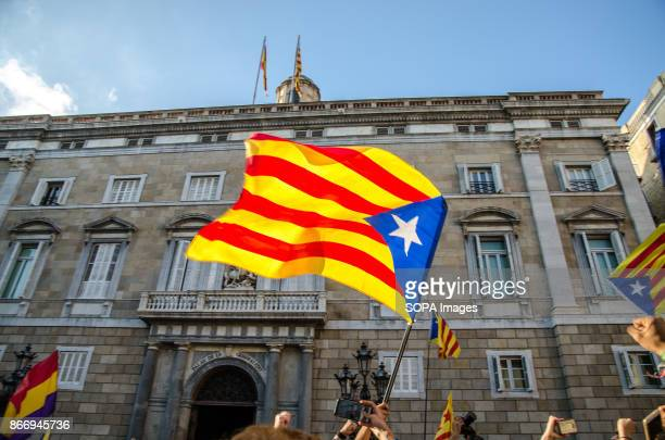 A proindependence flag of Catalonia flies in plaza Sant Jaume were students concentrated in Plaza Sant Jaume were awaiting for President Carles...