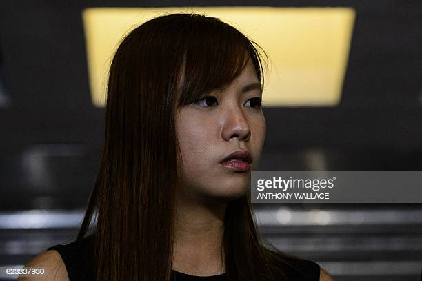 Proindependence lawmaker Yau Waiching reacts as she holds a press conderence with Baggio Leung outside the High Court in Hong Kong on November 15...