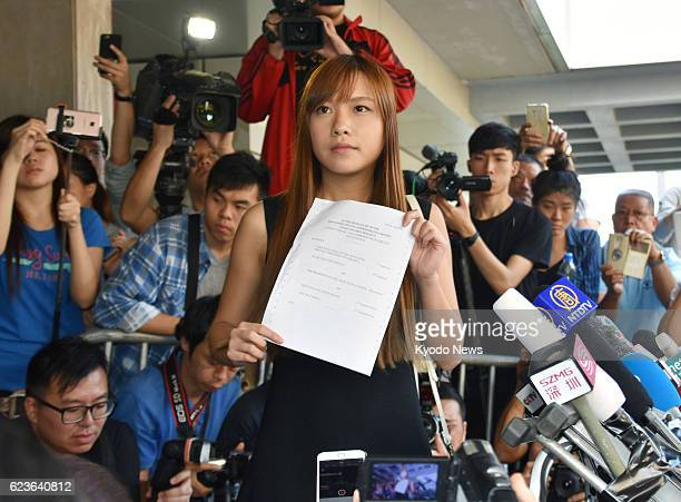 Proindependence lawmakerelect Yau Waiching holds up Hong Kong's High Court's decision to disqualify her and another proindependence lawmaker Sixtus...