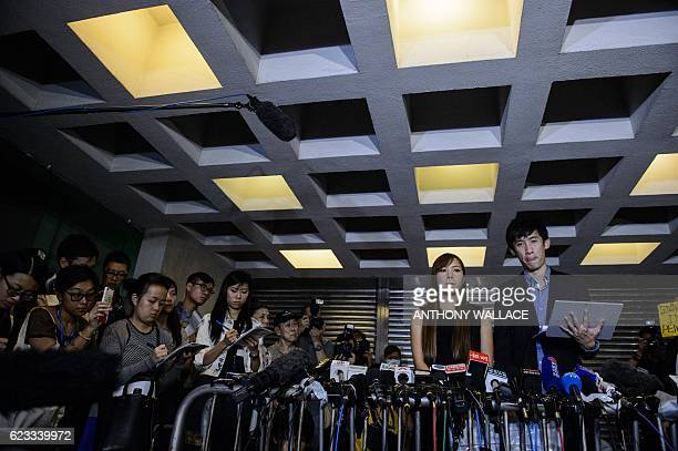 Proindependence lawmakers Baggio Leung and Yau Waiching react as they speak to the press outside the High Court in Hong Kong on November 15 after a...