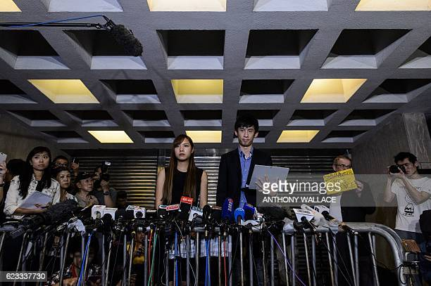 Proindependence lawmakers Baggio Leung and Yau Waiching speak to the press outside the High Court in Hong Kong on November 15 after a court ruled to...