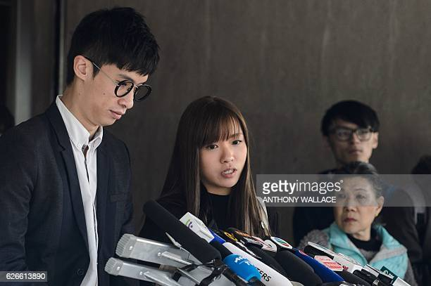 Proindependence lawmakers Baggio Leung and Yau Waiching speak to the press outside the High Court in Hong Kong on November 30 2016 Leung and Yau lost...