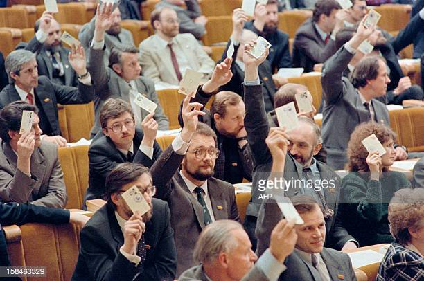 Proindependence members of the National Assembly of the Sajudis movement hold their votes on March 11 1990 in Vilnius during the first session of the...