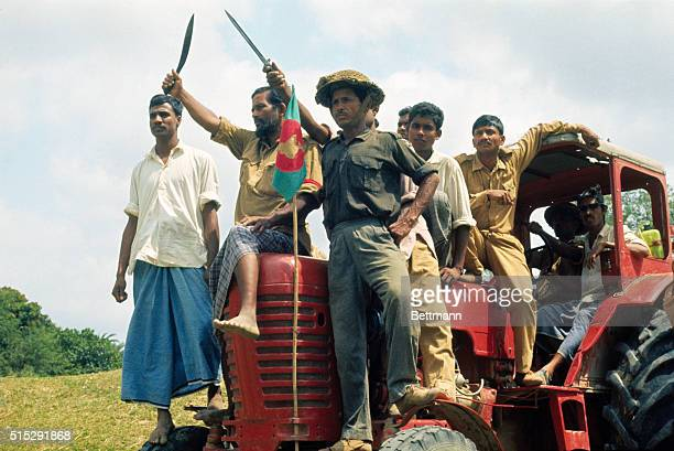 Bangladesh commandos perched atop a tractor at the Meshila Checkpost sing their battle song during the 1970 War for Independence