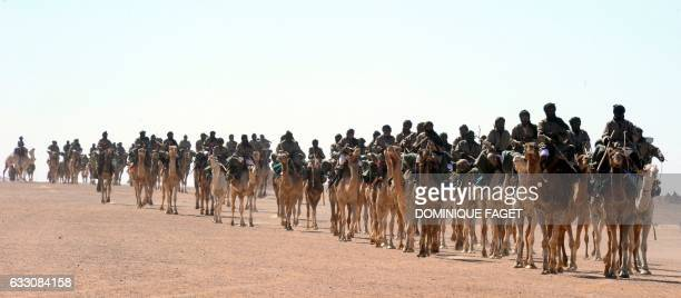 Proindependence Polisario Front rebel soldiers parade during a ceremony marking the 35th anniversary of the proclamation of independence of the...