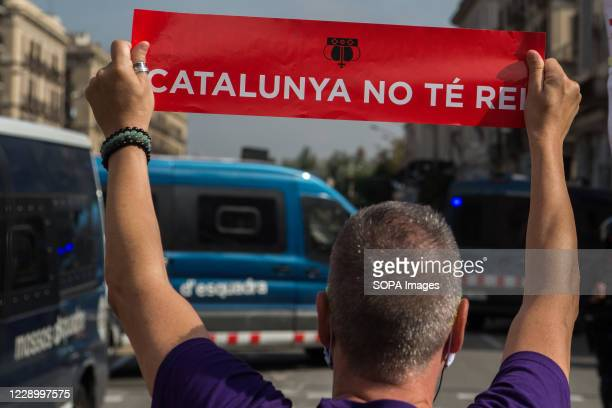 Pro-independence protester holding a placard saying 'Catalonia there is no king' during the demonstration. Anti-monarchical sympathizers for the...
