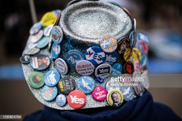 Pro-independence protester wears a hat covered in badges at a gathering in George Square, Glasgow on May 1 ahead of the upcoming Scottish Parliament...