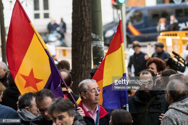 Proindependence protesters hold Spanish Republican flags as Carme Forcadell arrives at Supreme Court to be questioned over her role in Catalonia's...