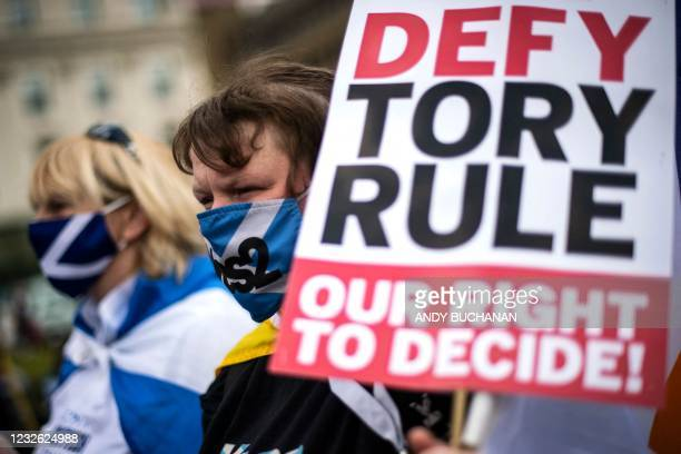 Pro-independence protesters wearing protective face coverings to combat the spread of the coronavirus, gather in George Square, Glasgow on May 1...
