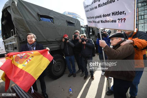 Proindependence protestors face an Unionist protestor holding a Spanish flag during a demonstration of proindepence Catalan mayors to show solidarity...