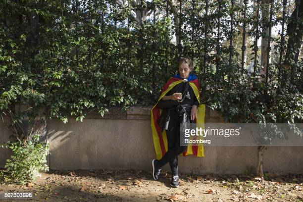 A proindependence supporter waits for the result of a vote for independence in Barcelona Spain on Friday Oct 27 2017 Catalonia is headed for a...