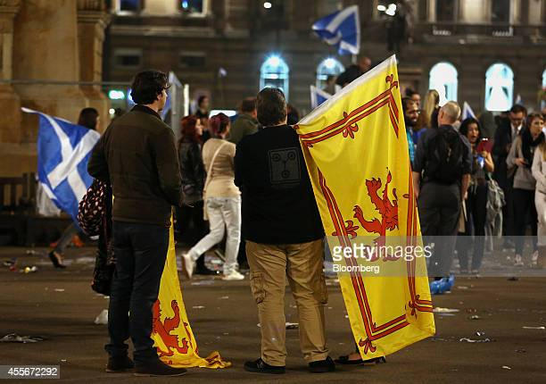 Proindependence 'yes' campaign supporters hold Royal Standard of Scotland flags during a demonstration at George square in Glasgow UK on Thursday...
