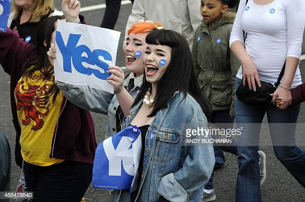 Proindependence 'Yes' campaigners stage a march towards the BBC Scotland Headquarters in Glasgow on September 14 2014 to protest against alleged...