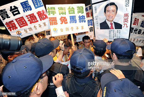 Proindependent activists from the Taiwan Solidarity Union holding a portrait of Taiwan President Ma Yingjeou's clash with policemen at the Taoyuan...