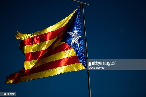 A proindependent Catalonia's flag flies on the outskirts of the village of Olot on November 20 2012 in Olot Spain Over 5 million Catalans will be...