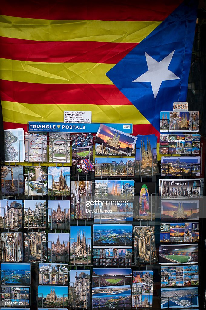 A Pro-independent Catalonia's flag is hanged above Barcelona's postcards in a souvenir shop on November 22, 2012 in Barcelona, Spain. Over 5 million Catalans will be voting in Parliamentary elections on November 25, with opinion polls showing majority support for pro-independence parties.