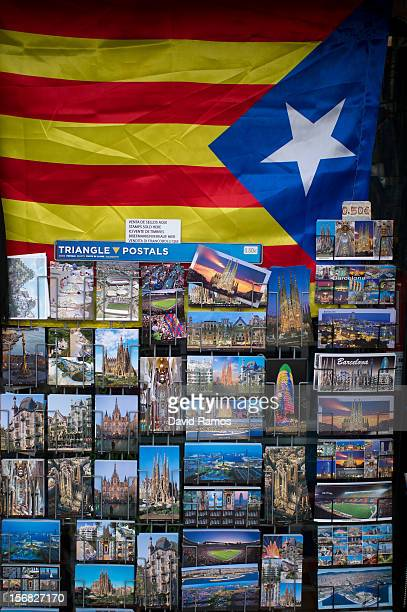 Proindependent Catalonia's flag is hanged above Barcelona's postcards in a souvenir shop on November 22 2012 in Barcelona Spain Over 5 million...