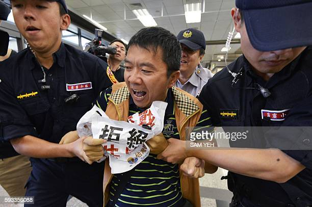 A proindependent protester from the Taiwan Solidarity Union is carried away by policemen as Sha Hailin Shanghai Municipal Committee United Front Work...