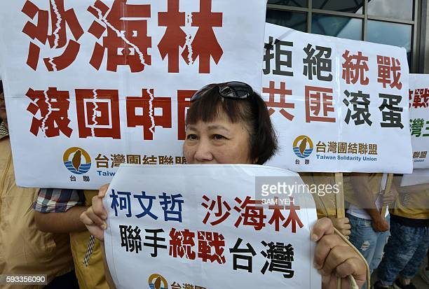 Proindependent protesters from the Taiwan Solidarity Union display placards that read 'Sha Hailin Shanghai Municipal Committee United Front Work...