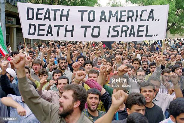 ProIranian Hezbollah supporters demonstrate against the United States of America and Israel 30 Ocober 1991 in Beirut protesting the ongoing peace...