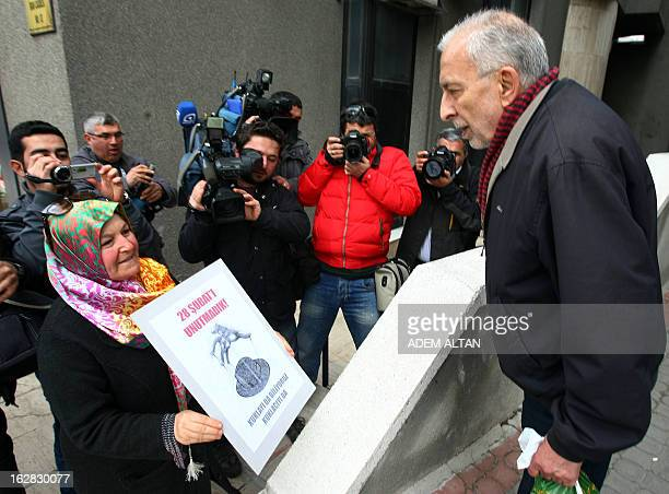 A proIslamic demonstrator shows a placard on February 28 reading We have not forgotten February 28 during a protest near the residence in Ankara of...