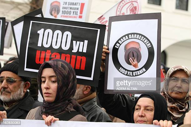 ProIslamic demonstrators hold on February 28 2013 posters reading We have not forgotten February 28 during a protest near the residence in Ankara of...