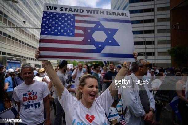 Pro-Israel demonstrators attend a rally denouncing antisemitism and antisemitic attacks, in lower Manhattan, New York on May 23, 2021.