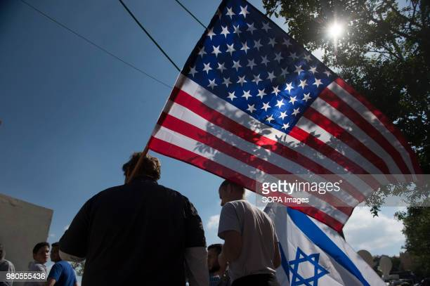 ProIsrael protesters hold American and Israel flags on the day of the US Embassy inauguration at the US Consulate building in Jerusalem Israel troops...