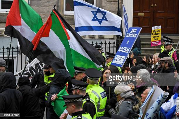 ProIsraeli and Pro Palestine demonstrators try and stop each other from marching during an antiracism rally through the city centre on March 17 2018...