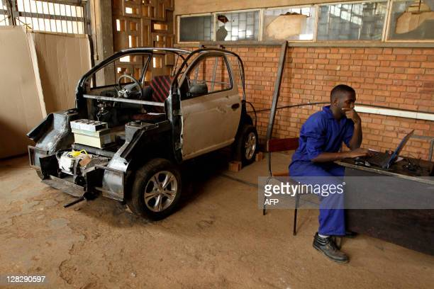 A project assistant at the Makerere University looks at the skeleton on his computer the Kiira EV the first electric car built in Uganda on June 23...