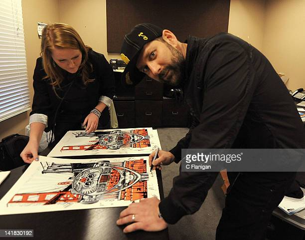 Project Coordinator at HeadCount Jane Henderson and Musician Mark Brownstein of The Disco Bicuits sign official posters for the Yahoo Music Presents...