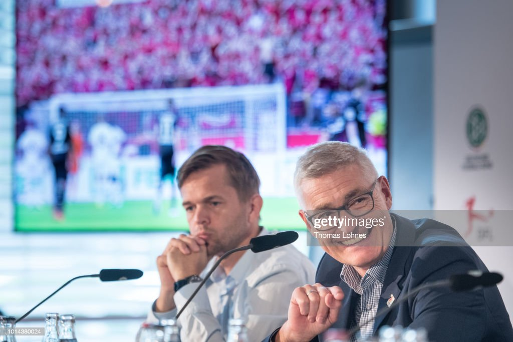 Project director 'Video Assitant Referee' Jochen Drees (L) and DFB referee manager Lutz Michael Froehlich (R) speak to the media during a press conference of Deutscher Fussball-Bund (DFB) on August 10, 2018 in Frankfurt am Main, Germany.
