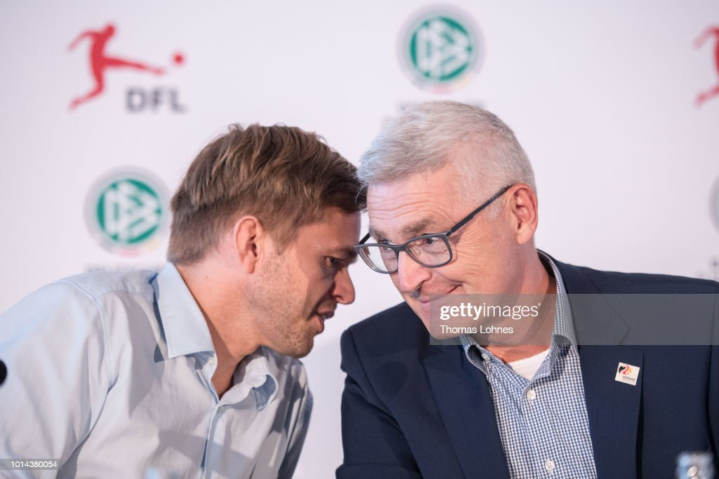 Project director 'Video Assitant Referee' Jochen Drees (L) and DFB referee manager Lutz Michael Froehlich (R) react during a press conference of Deutscher Fussball-Bund (DFB) on August 10, 2018 in Frankfurt am Main, Germany.