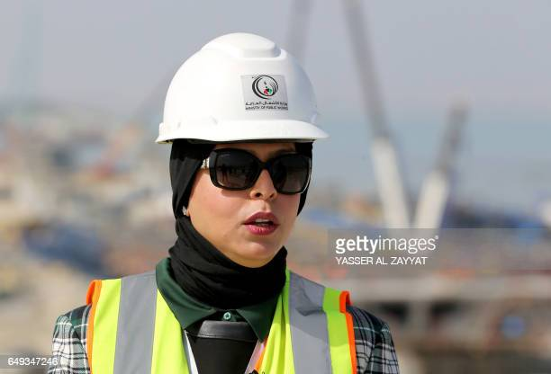 Project engineer Mai alMessad talks to reporters at the construction site of the Jaber Causeway in Kuwait City on February 11 2017 Kuwait is building...