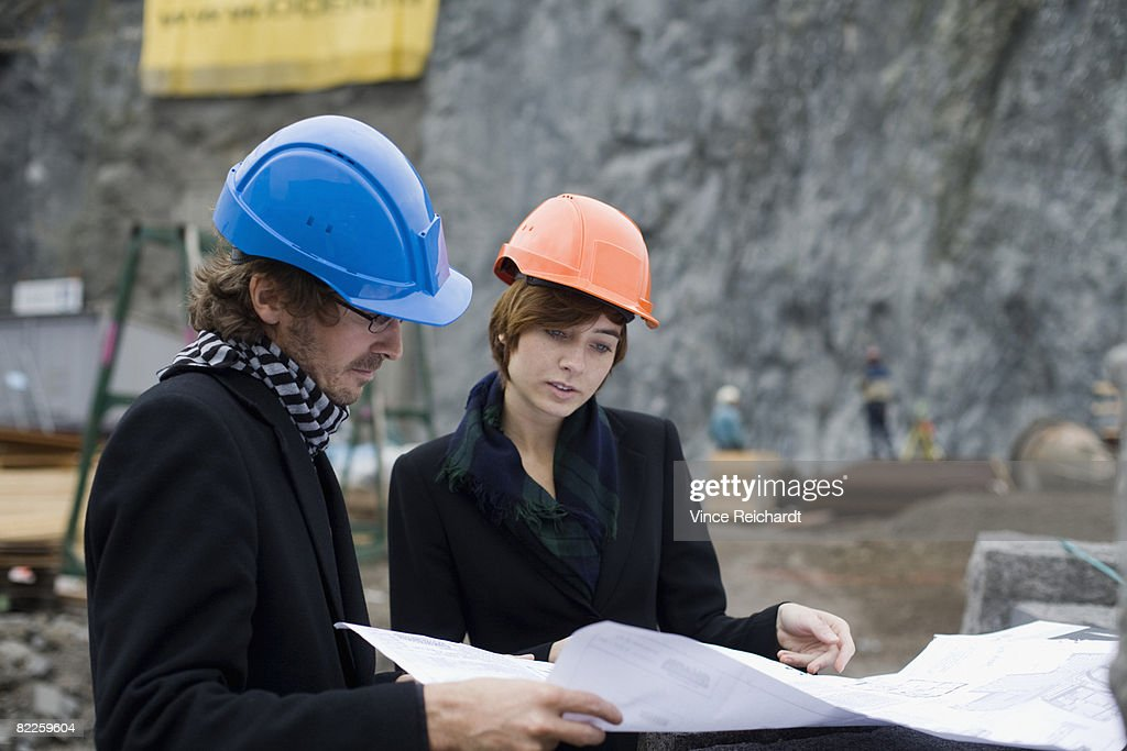 Project leaders at a building site a man and a woman Sweden. : Stock Photo