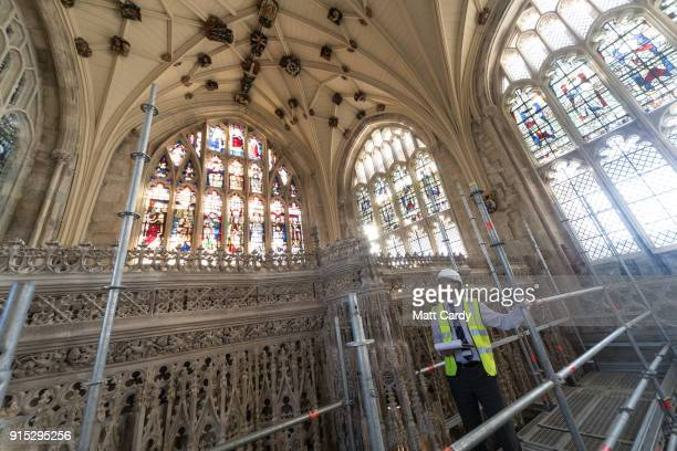 Project manager Greg Hamilton looks at the work that has been completed to clean accumulated dust and dirt from the intricate stone surface of the...