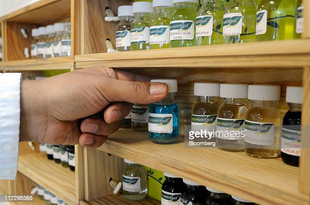A Project Propec employee handles research samples of fertilizer additives at the Agronutrition SAS headquarters in Carbonne France on Wednesday...