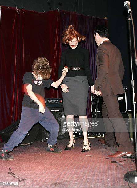 'Project Runway' designer Laura Bennett and her children perform during an air guitar competition during the afterparty for 'Air Guitar Nation' at...