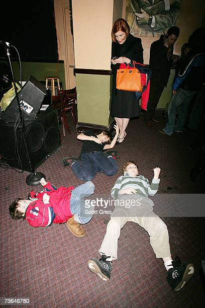 'Project Runway' designer Laura Bennett waits while her children practice for an air guitar competition during the afterparty for 'Air Guitar Nation'...