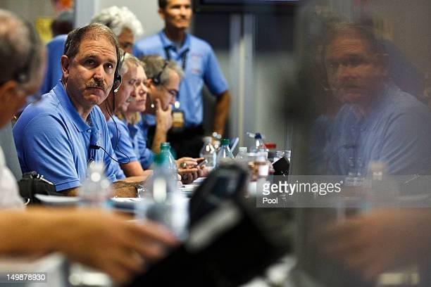 Project Scientist John Grunsfeld listens inside the Spaceflight Operations Facility for NASA's Mars Science Laboratory Curiosity rover at Jet...
