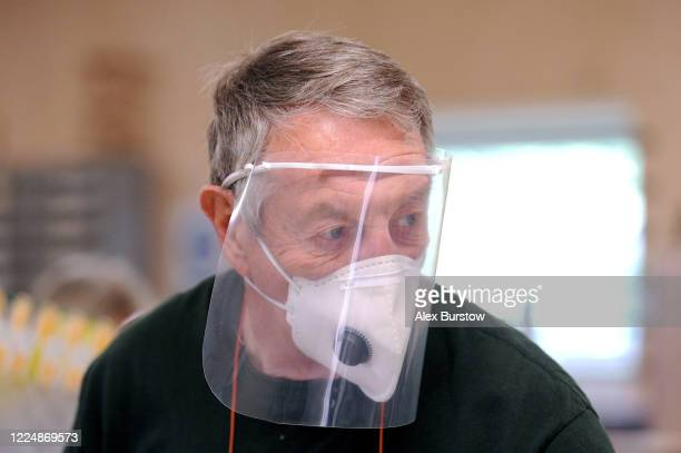 'Project Shield' volunteer Gary G looks on as he helps to produce fullface visors in the Church Crookham and Fleet Men's Shed on May 06 2020 in...