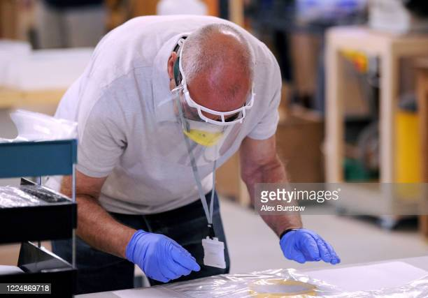 'Project Shield' volunteer Martin helps to count and package fullface visors in the Church Crookham and Fleet Men's Shed on May 06 2020 in Church...