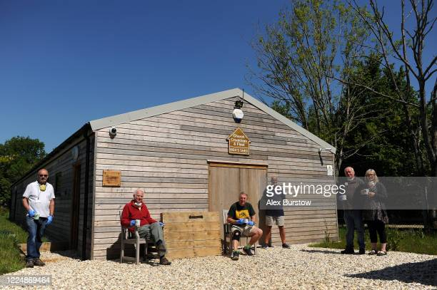 'Project Shield' volunteers Martin Trevor Gary G Allan Gary C and Loila pose for a photo outside the shed as they take a quick break from production...