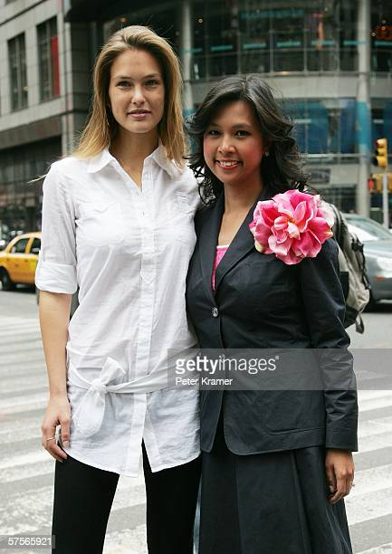 Project Sunshine spokesmodel Bar Refaelii and NASDAQ VP Maribel Aber attend the NASDAQ closing bell in Times Square on May 9 2006 in New York City