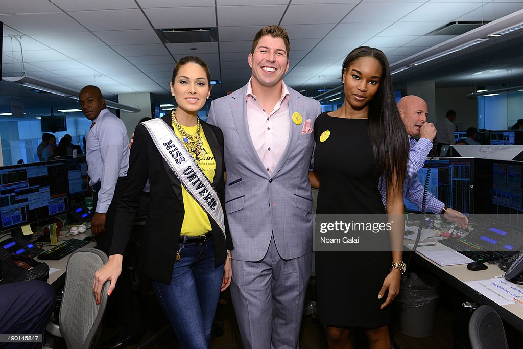 Project Sunshine supporters Miss Universe 2013 Gabriela Isler, David Diehl and Damaris Lewis participate in BTIG's 12th annual Commissions for Charity Day on May 13, 2014 in New York City.
