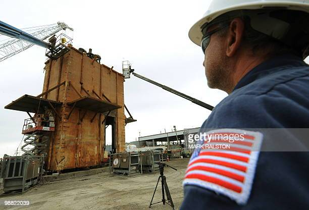 Project supervisor Sidney Aucoin watches as the Pollution Control Dome is built by steelworkers at the Martin Terminal worksite in Port Fourchon as...