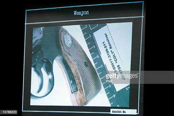 Projected crime scene evidence photos are displayed of the handgun that killed Lana Clarkson during the murder trial of music producer Phil Spector...